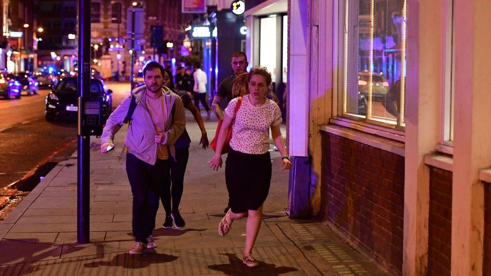 """People run down Borough High Street as police are dealing with a """"major incident"""" at London Bridge"""