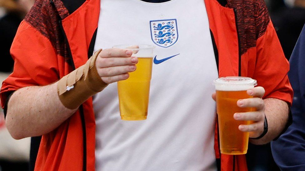 Football fan with two pints