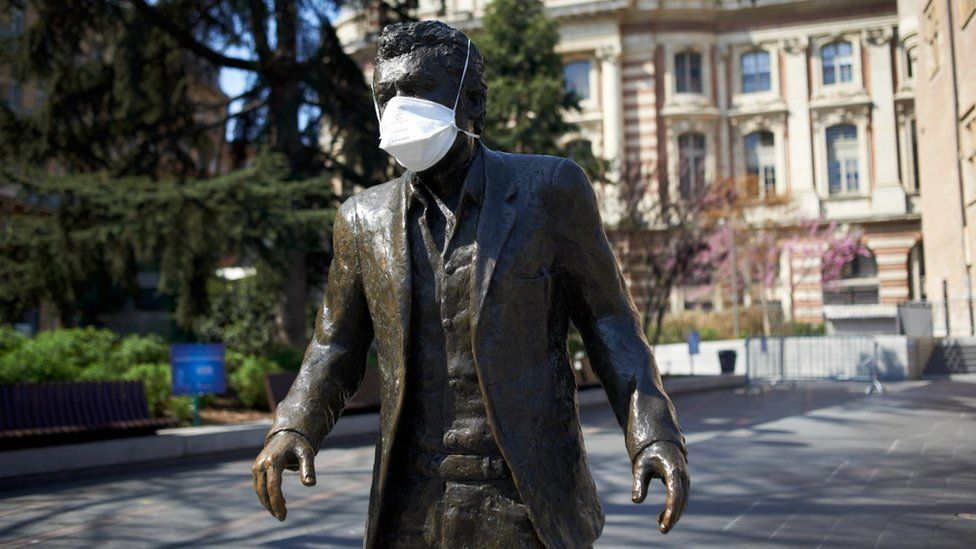 A facemask on a statue of well known singer Claude Nougaro in Toulouse in early April