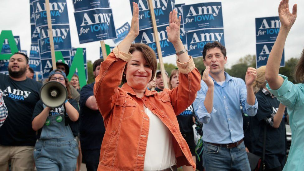 Senator Amy Klobuchar marches into the Polk County Steak Fry