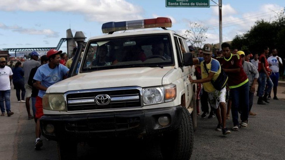 An ambulance at the scene where several people were injured during clashes in the southern Venezuelan town of Kumarakapay
