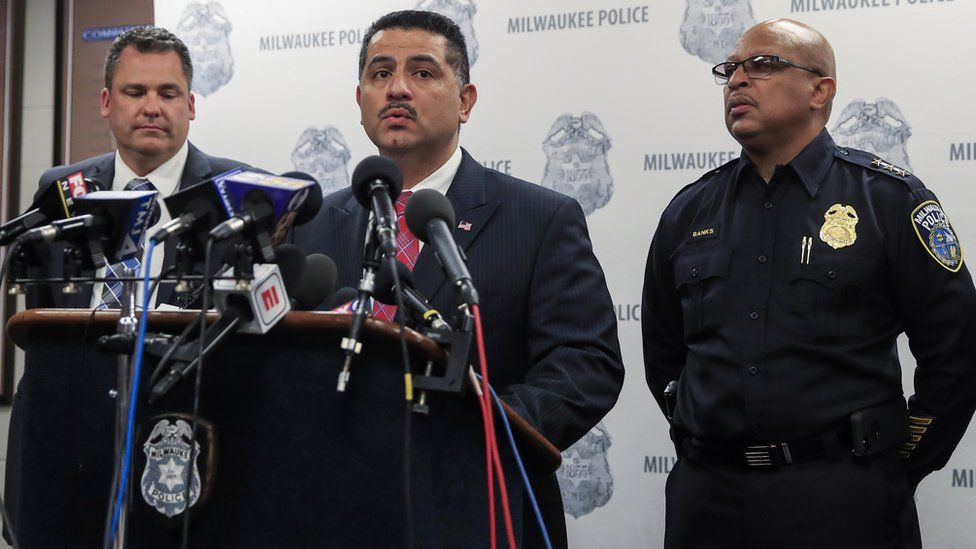 Milwaukee police chief Alfonso Morales, centre, making a statement to the press