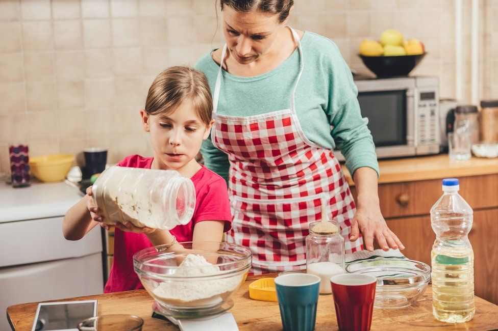 Woman and child baking