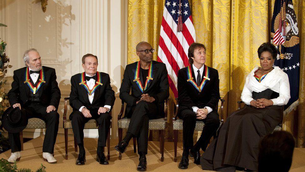 Paul McCartney next to Oprah Winfrey at the White House