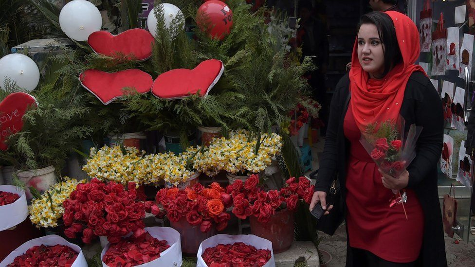 Woman in Kabul carrying roses