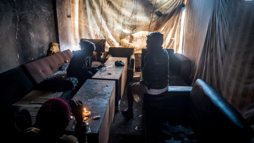Residents as seen sitting in a room of the derelict San Jose building in Johannesburg, South Africa