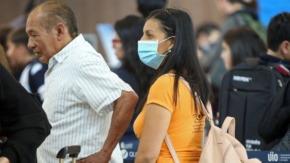A passenger wears a protective mask at Mariscal Sucre International Airport, regarding the spread of the COVID-19 virus worldwide, in Quito, on March 1, 2020.