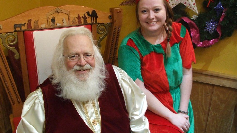 Santa Claus and one of his little helpers