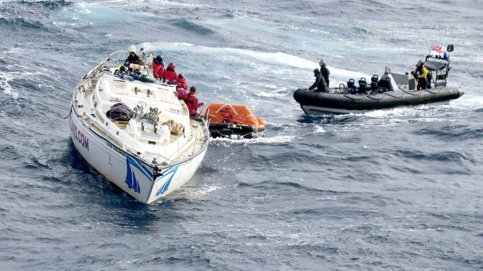 HMS Dragon crew recovering yacht crew