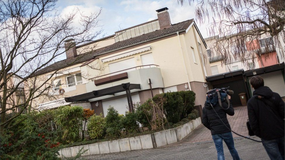 A camera man films a residential building in Sulzbach, Germany, 9 December 2015