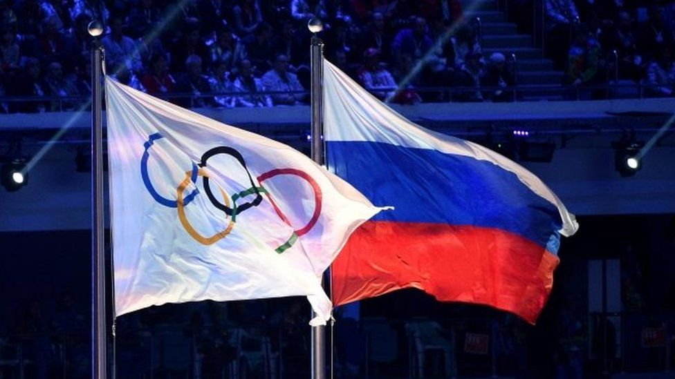 Olympic and Russian flags at the Sochi Winter Olympics. Photo: February 2014