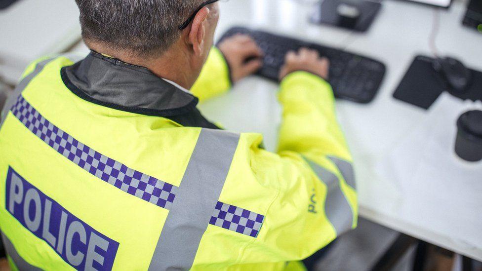 Policeman on computer