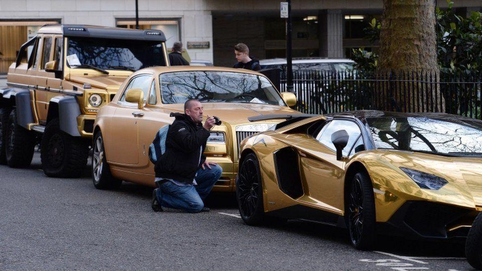 Fleet of gold cars in Knightsbridge