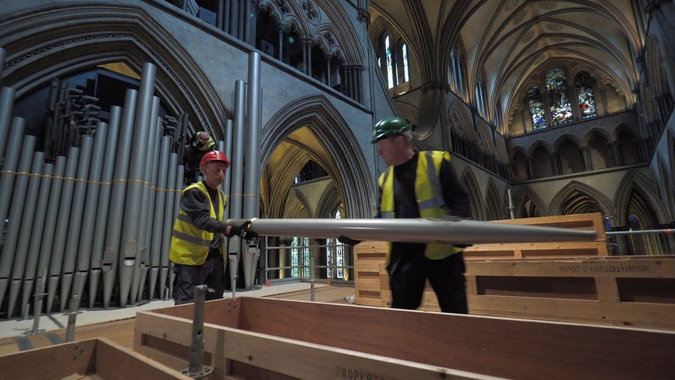 Restorers removing organ pipes