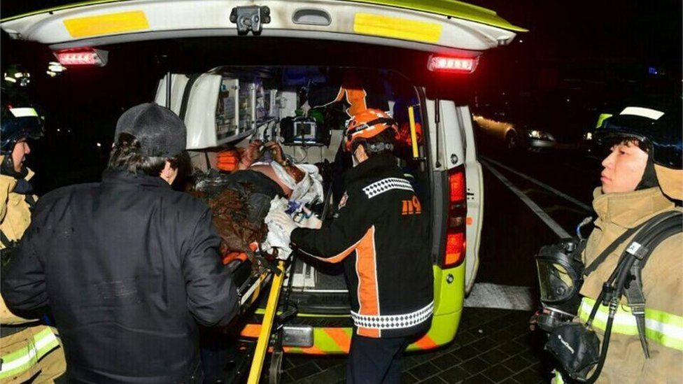 In this 7 January 2017 file photo, an injured Buddhist monk who set himself on fire is put into an ambulance in Seoul, South Korea.