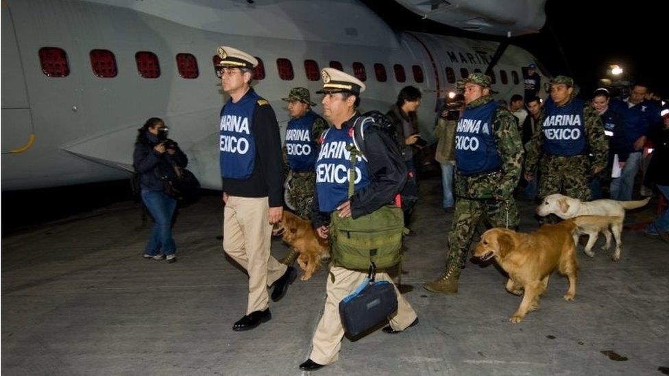 Members of Mexican Navy along with sniffer dogs prepares to depart Mexico city for Haiti on January 13, 2010. Rescuers, sniffer dogs, equipment and supplies headed to Haiti in 2010