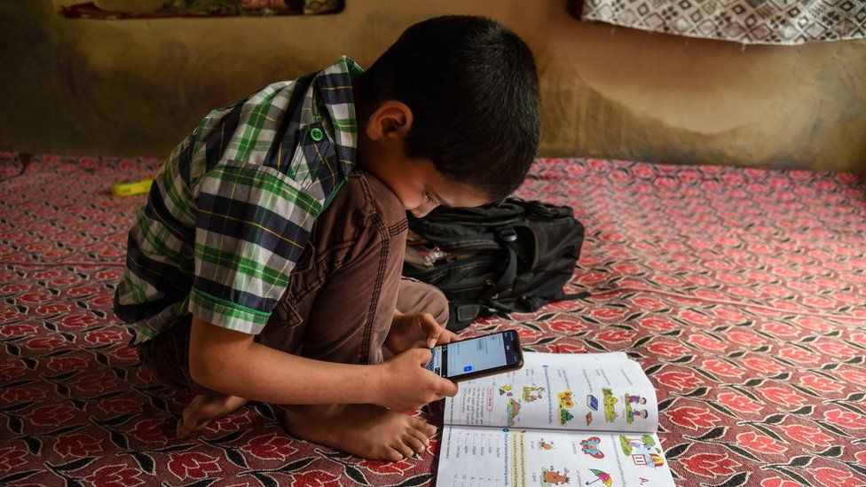 a child uses Zoom for homework