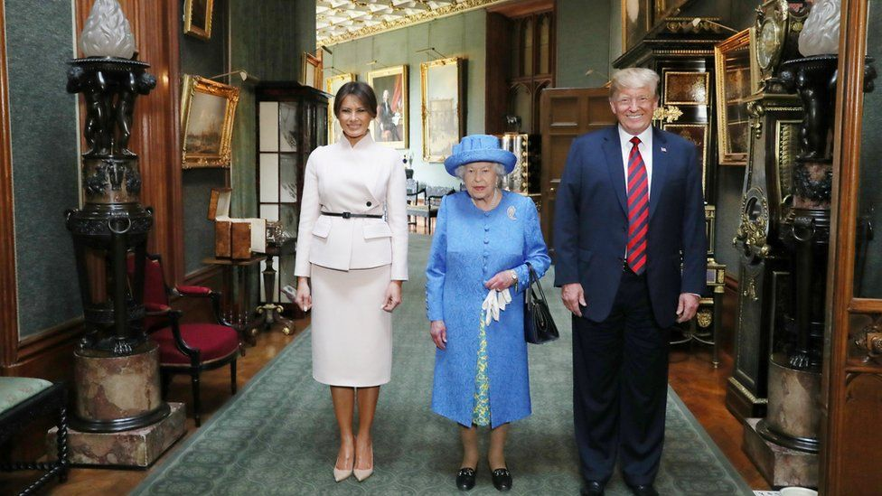 The Queen stands with Donald Trump and his wife, Melania in the Grand Corridor during their visit to Windsor Castle