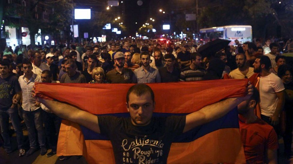 Anti-government protesters, supporters of the armed group who have been holed inside a police station, prepare to march in Yerevan, Armenia, Saturday, July 30, 2016