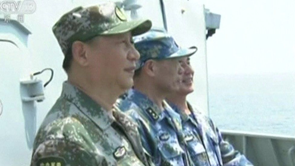 Chinese leader Xi Jinping inspects troops at a undisclosed location in the South China Sea