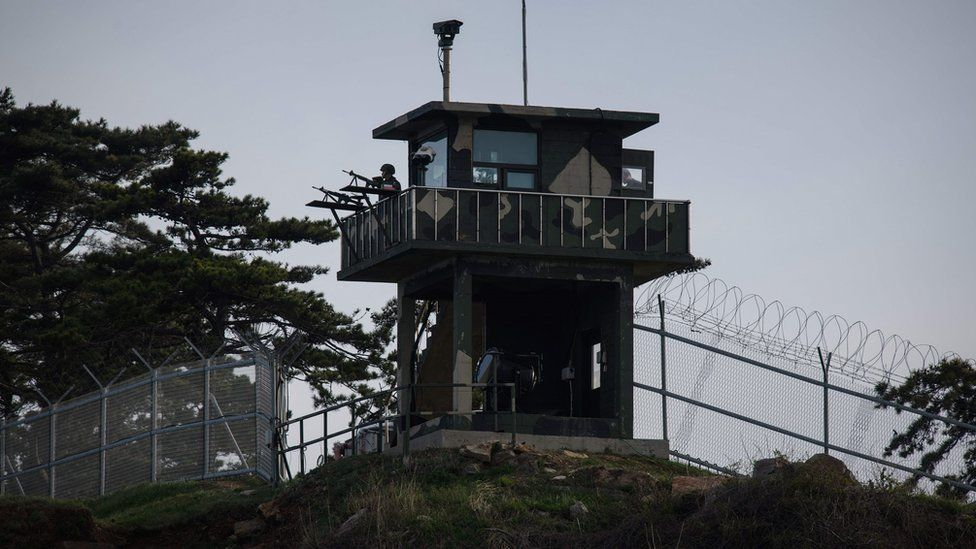 Soldiers in a watchtower on the shore of Yeonpyeong