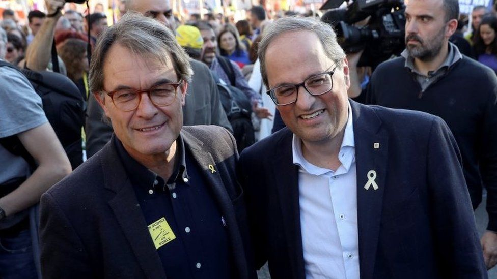 Catalonia's regional government president Quim Torra (right) and his predecessor Artur Mas (left) were at the rally