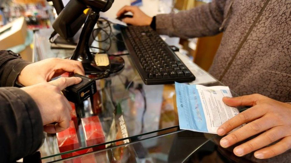 A man has his identity checked with a digital scanner before buying legal marijuana in a pharmacy in Montevideo, Uruguay July 19, 2017.