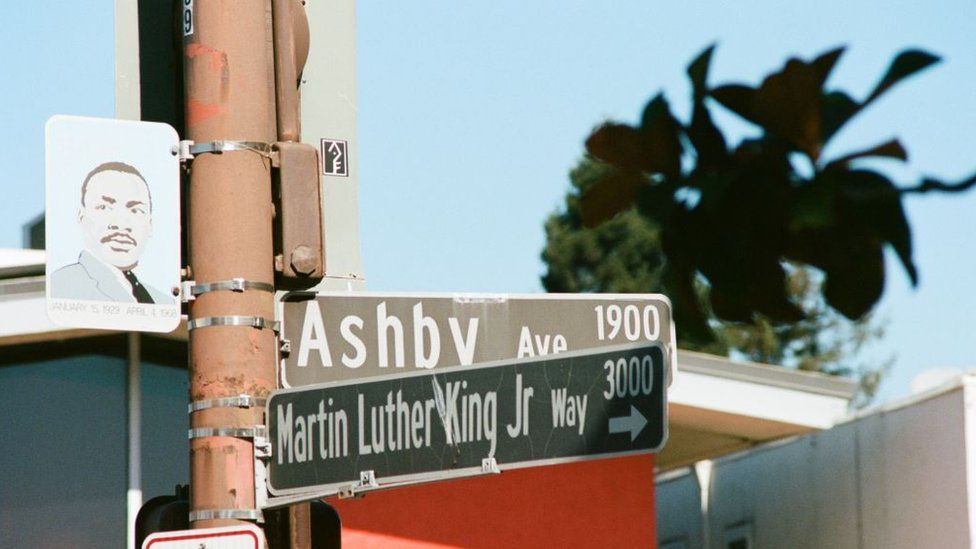 Close-up of sign at the intersection of Martin Luther King Jr Way in Berkeley, California