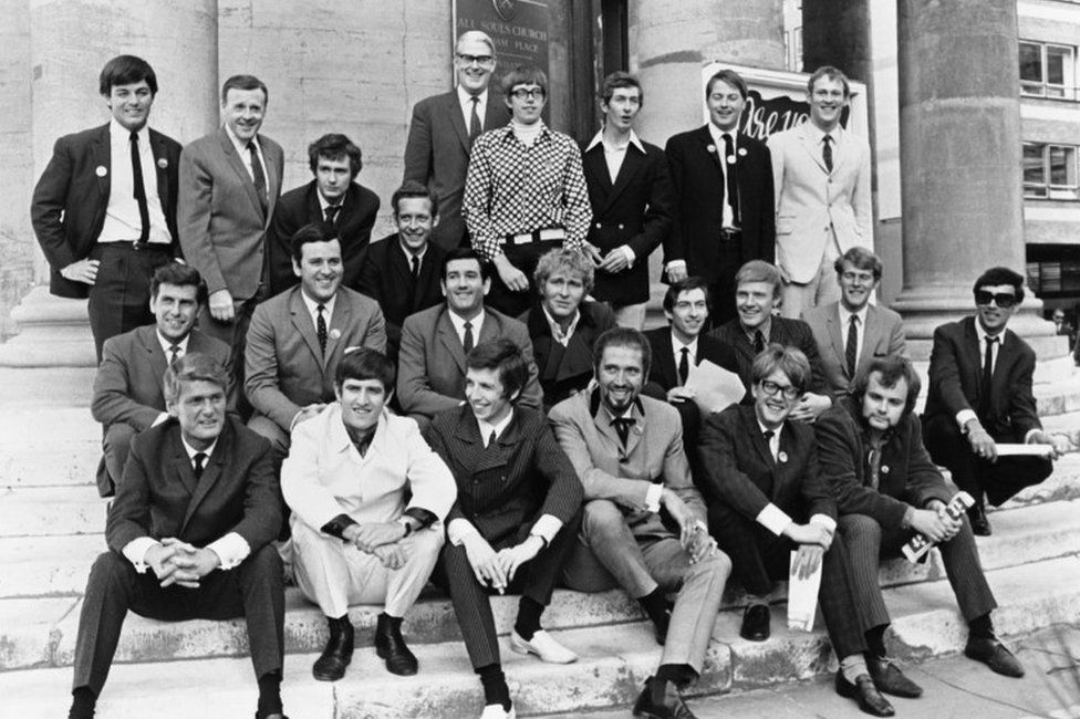 Picture shows - Mr Robin Scott, Controller of the Light Programme, who will be in charge of Radio One and Radio Two, to be inaugurated on September 30th 1967, standing behind disc jockeys (DJs) who will feature in his programme. Disc Jockeys photographed outside All Souls Church, Langham Place, as BBC Radio 1 (Radio One) and Radio 2 (Radio Two) networks announce their line-ups near BBC Broadcasting House, September 4th 1967. Photographed Front Row (l-r) : Pete Murray, Ed Stewart, Pete Drummond, Mike Raven, Mike Ahern and John Peel. Middle Row : Bob Holness, Terry Wogan, Barry Alldis, Mike Lennox, Keith Skues, Chris Denning, Johnny Moran and Peter Myers. Back Row : Tony Blackburn, Jimmy Young, Kenny Everett, Duncan Johnson, Robin Scott, David Ryder, Dave Cash, Pete Brady and David Symonds.