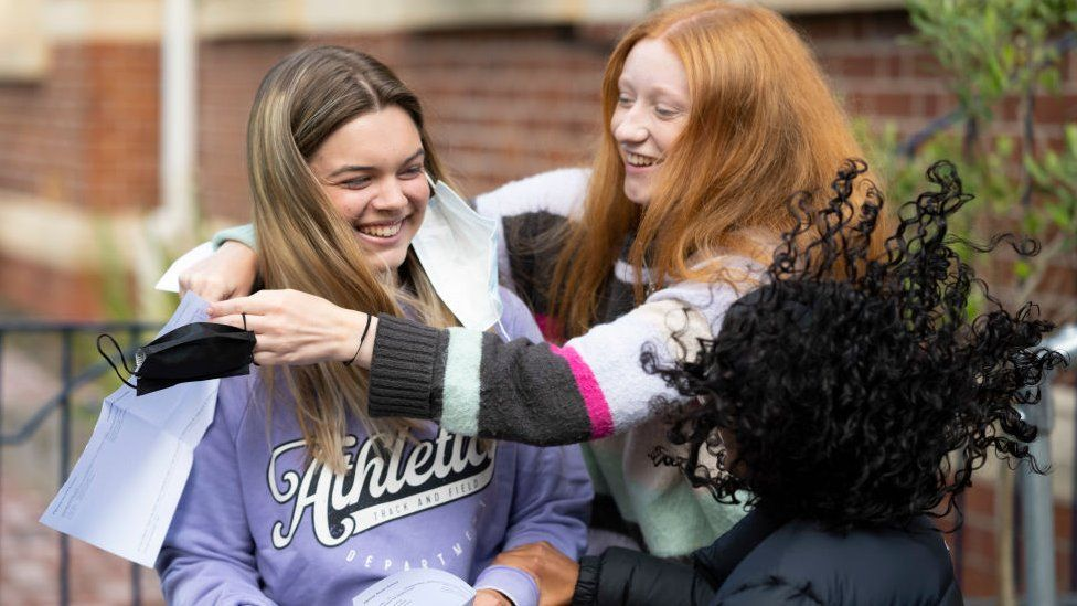 Emelia Ambrose embraces her friend Mali Jones after opening her A Level results at Ffynone House school