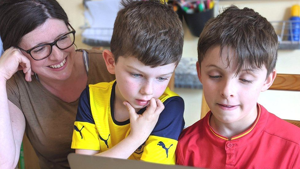 Ruth Moore shows her sons how to code