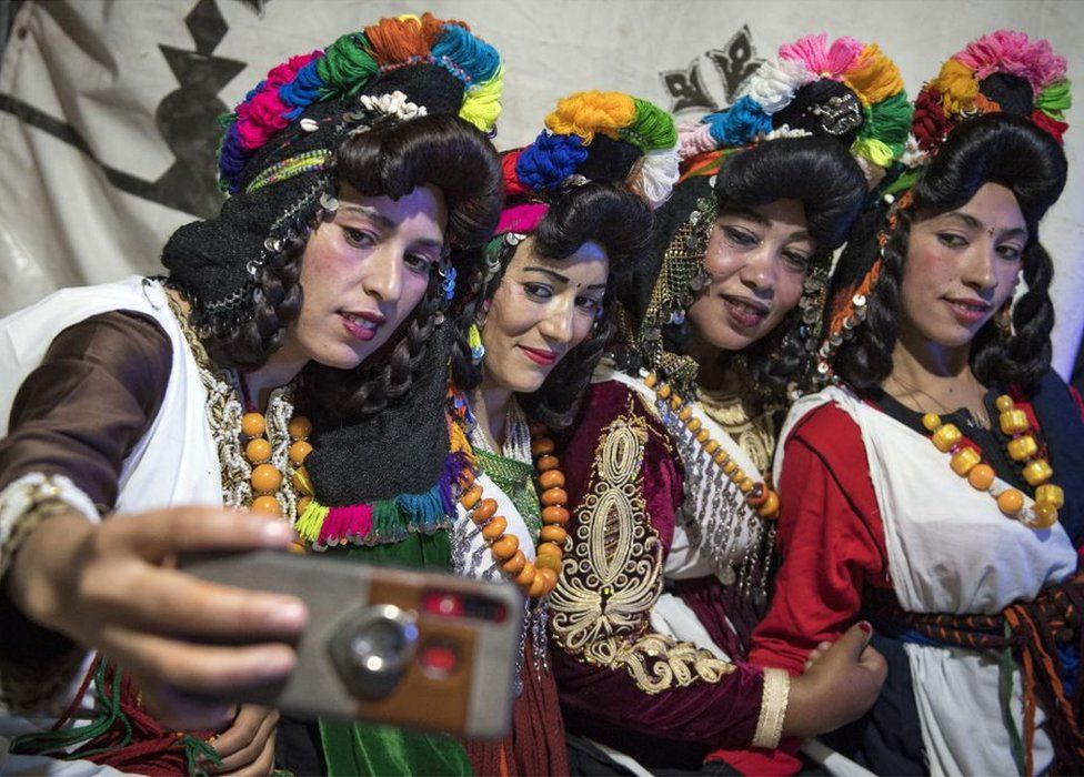 Young Amazigh women pose for a selfie during the annual Engagement Moussem festival near the village of Imilchil in central Morocco's high Atlas Mountains - 21 September 2019