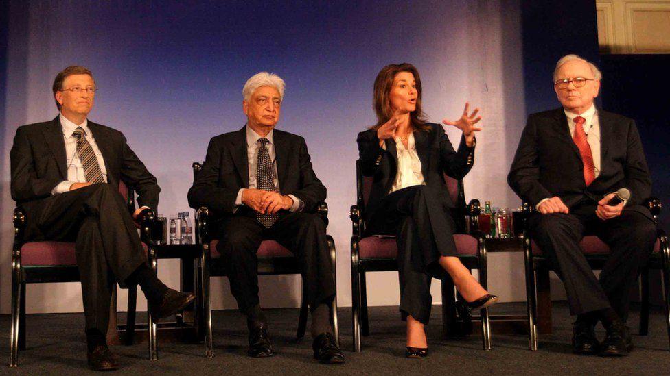 (L-R) Bill Gates, Azim Premji , Melinda Gates and Warren Buffet during a press conference in New Delhi on March 24, 2011.