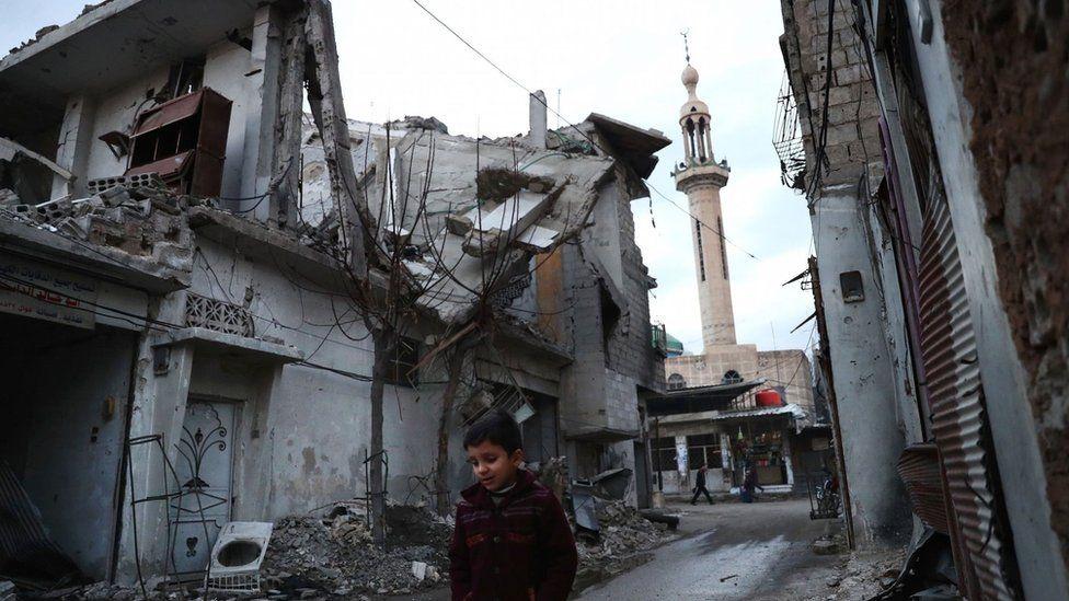 A Syrian boy walks through rebel-held Douma, near Damascus (9 January 2017)