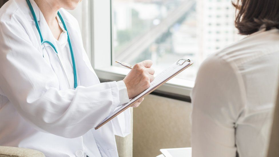 Woman going for screening and talking to a doctor