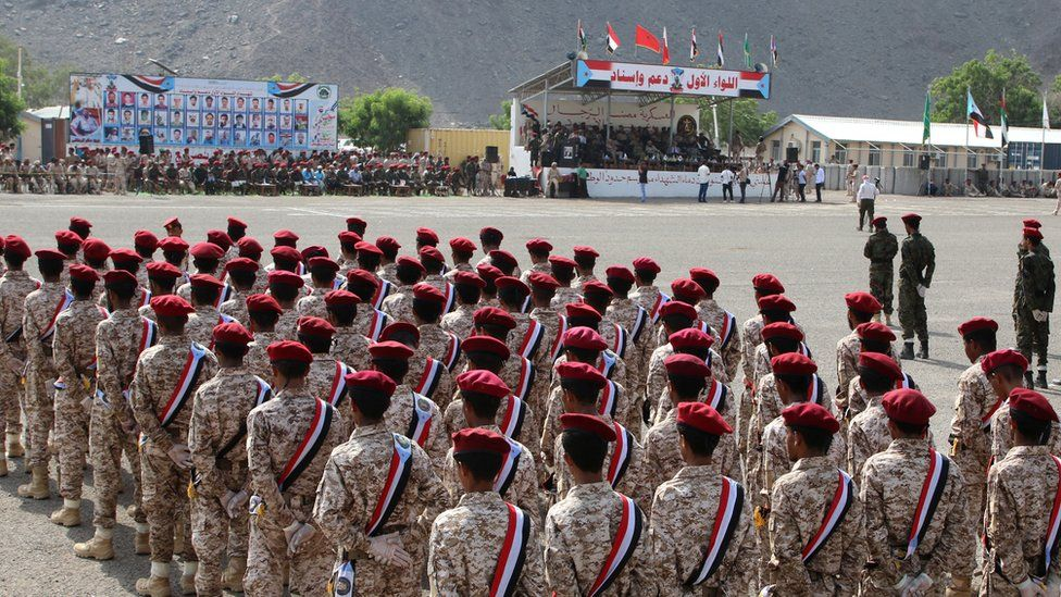 Newly-recruited troopers take part in a graduation parade in Aden shortly before the attack
