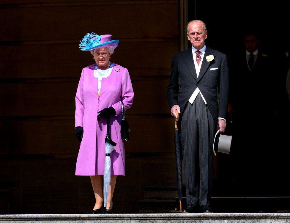 Queen Elizabeth and Prince Philip at a garden party