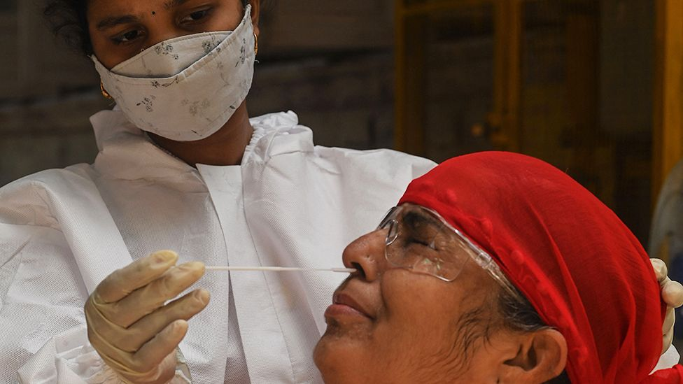 A medical staff takes a nasal swab for a Rapid Antigen Testing (RAT) test amidst rising Covid-19 coronavirus cases, in Mumbai on April 19, 2021