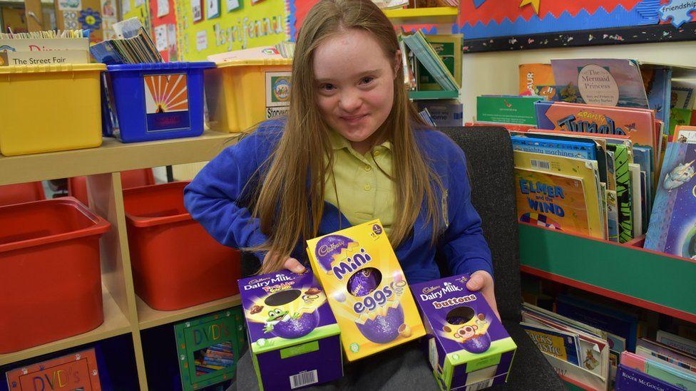 Hollie Evans holding chocolate eggs