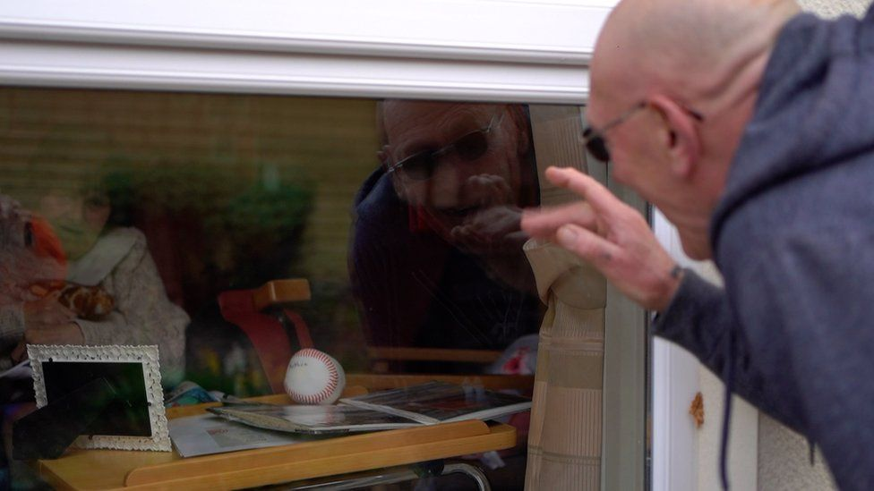 David Capewell greets wife Anthea through care home window