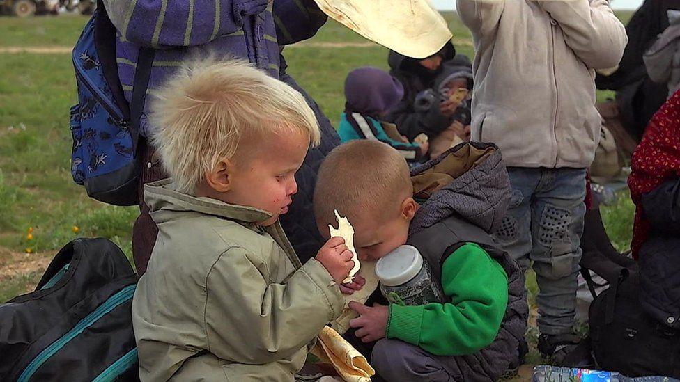 Children from Russia are photographed huddled together