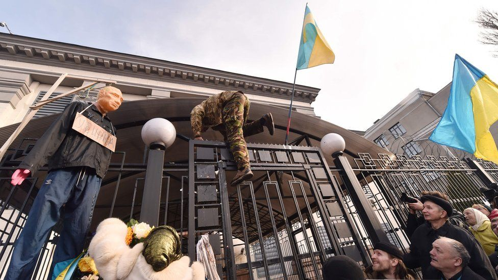 Protester climbs over Russian embassy fence