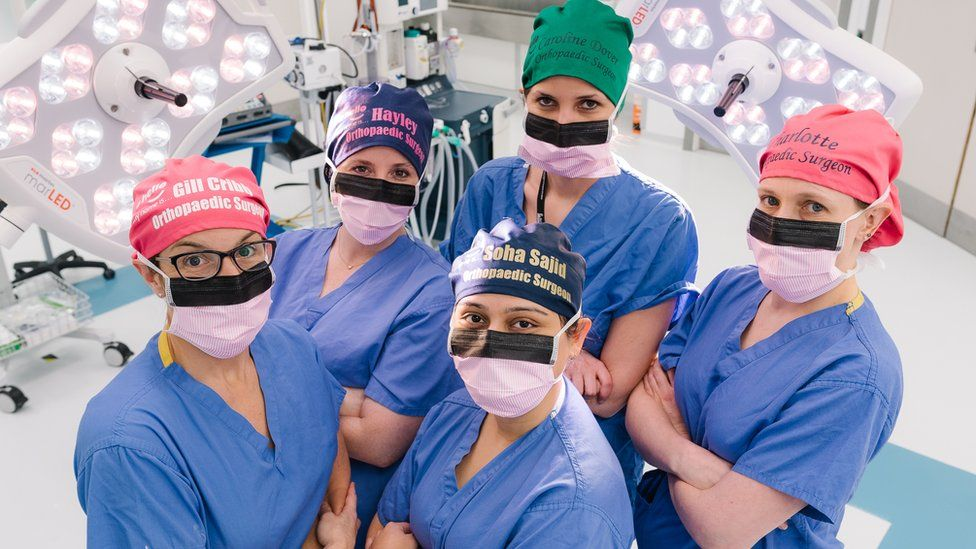 Female surgery staff wearing the scrub caps