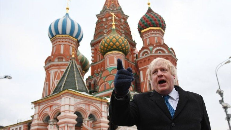 """Boris Johnson stands in front of Saint Basil""""s cathedral in Red square in Moscow"""