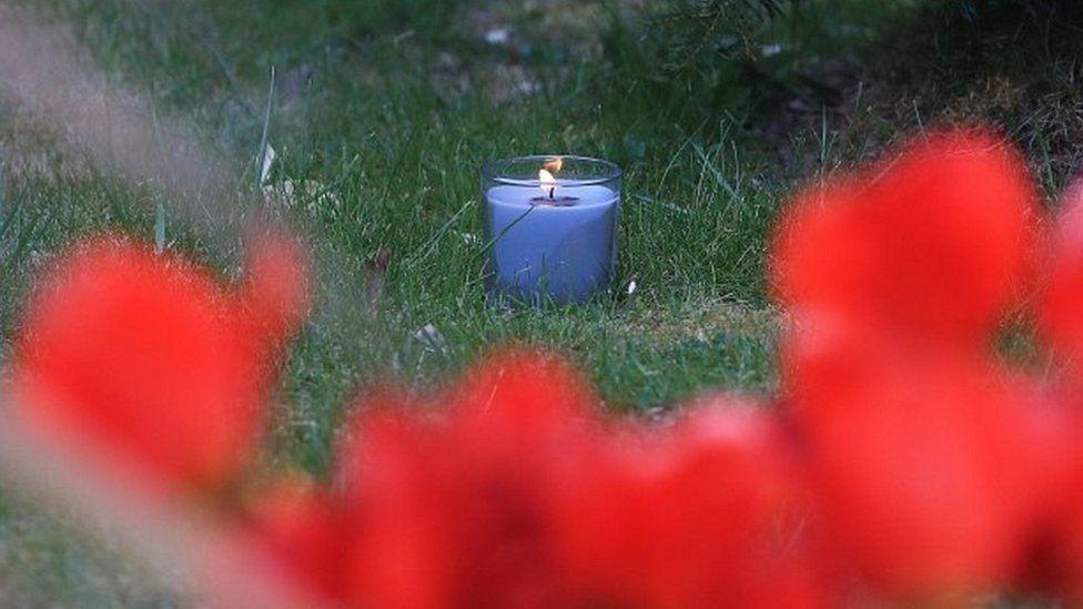 A lit candle marks one week since the death of PCSO Julia James, at her family home in Snowdown, near Aylesham