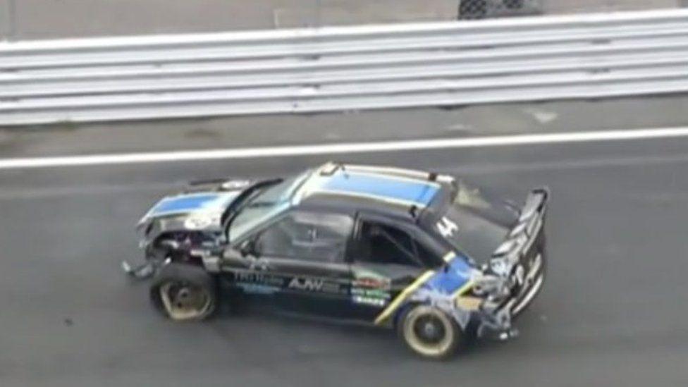 The damaged car after the crash