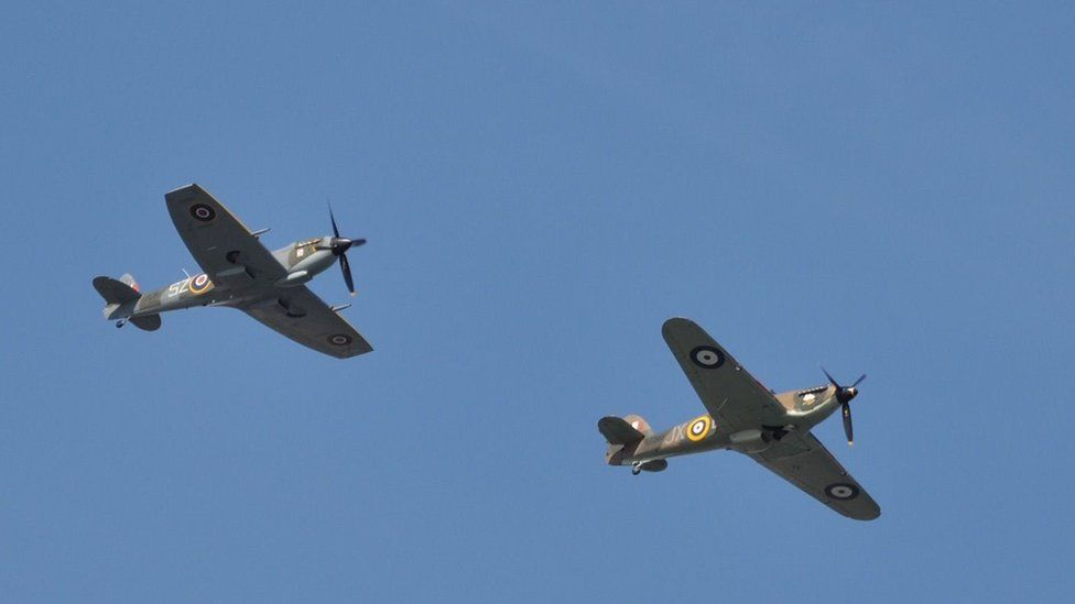 Spitfire and Hurricane aircraft fly next to each other