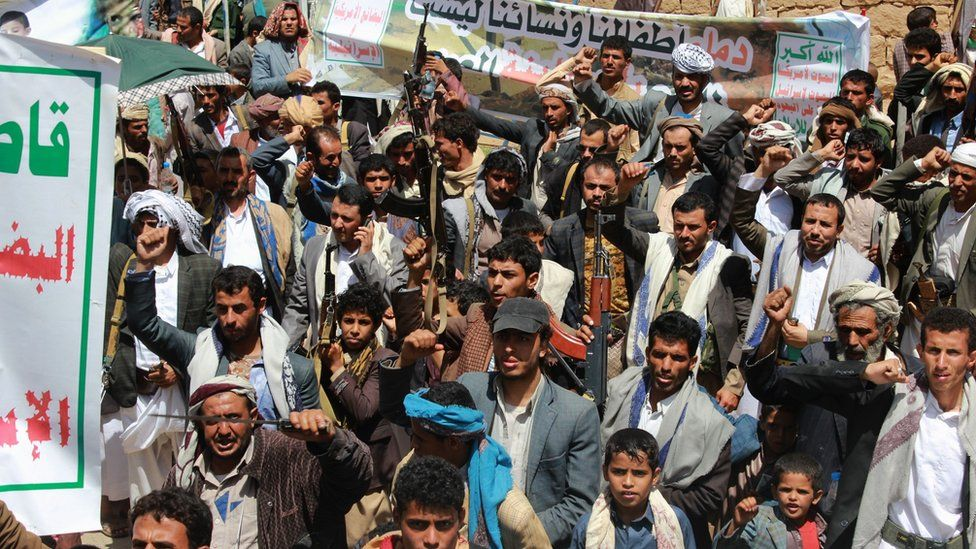 Houthi supporters in Saada raise their rifles and chant slogans at protest against Saudi-led coalition air strike on Dahyan, Yemen (5 September 2018)