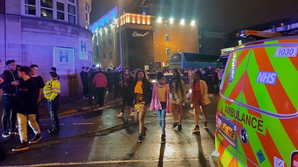 Ambulance and crowds outside Rock City