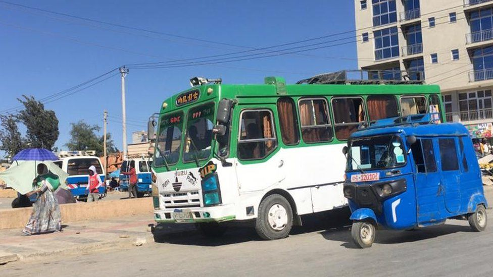 A bus and tuk tuk in Mekelle, Ethiopia - November 2020